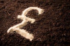 Logo pound symbol written on sand earthen background Stock Images