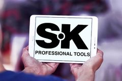 Logo professionale della società degli attrezzi per bricolage della SK Fotografie Stock