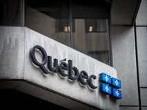 Logo of the provincial government of Quebec Gouvernement du Quebec on administrative building. Picture of an administrative building in Montreal, Canada, with royalty free stock photo