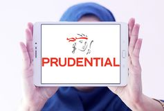 Prudential plc financial services company logo. Logo of Prudential plc on samsung tablet holded by arab muslim woman. Prudential plc is a British multinational Stock Photo