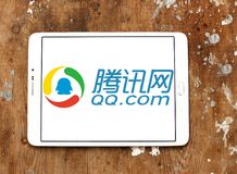 QQ.com logo. Logo of QQ.com on samsung tablet on wooden background. Tencent QQ is an instant messaging software service developed by the Chinese company Tencent royalty free stock photography