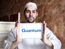 Quantum Corporation logo. Logo of Quantum Corporation on samsung tablet holded by arab muslim man. Quantum Corporation is a manufacturer of data storage devices royalty free stock photography