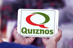 Quiznos fast food restaurant logo. Logo of Quiznos fast food restaurant on samsung tablet. Quiznos, is a franchised fast-food restaurant brand based in Denver stock images