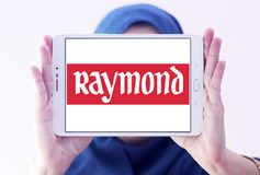 Raymond Group logo. Logo of Raymond Group on samsung tablet holded by arab muslim woman. Raymond Group is an Indian branded fabric and fashion retailer. It Royalty Free Stock Photo