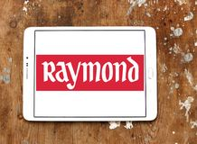 Raymond Group logo. Logo of Raymond Group on samsung tablet on wooden background. Raymond Group is an Indian branded fabric and fashion retailer. It produces Royalty Free Stock Photos