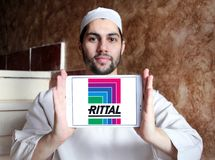 Rittal technology company logo. Logo of Rittal technology company on samsung tablet holded by arab muslim man. Rittal is a German company. The company stock image