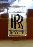 Logo of Rolls Royce on brown car Royalty Free Stock Photos