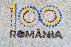 Logo 100 Romania centenary of the Great Union. The logo of the centenary of the Great Union, celebrating the 100th anniversary of the Romanian state, made with royalty free stock photo