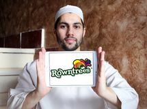 Rowntree`s food brand logo. Logo of Rowntree`s food on samsung tablet holded by arab muslim man. Rowntree is an English confectionery business stock photography