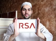 RSA Security company logo. Logo of RSA Security company on samsung tablet holded by arab muslim man. RSA, is an American computer and network security company Royalty Free Stock Photography