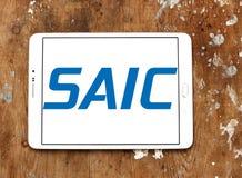 SAIC, Science Applications International Corporation logo. Logo of SAIC, Science Applications International Corporation on samsung tablet on wooden background Royalty Free Stock Photo