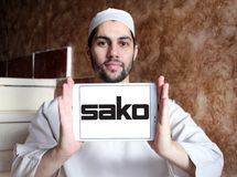 SAKO Finnish firearm company logo. Logo of SAKO company on samsung tablet holded by arab muslim man. SAKO is a Finnish firearm and ammunition manufacturer royalty free stock photo