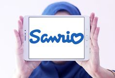Sanrio company logo. Logo of Sanrio company on samsung tablet holded by arab muslim woman. Sanrio is a Japanese company that designs, licenses and produces royalty free stock image
