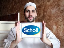 Scholl footcare solutions company logo. Logo of Scholl footcare on samsung tablet holded by arab muslim man. Scholl provides an ever growing range of footcare Royalty Free Stock Photos