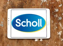 Scholl footcare solutions company logo. Logo of Scholl footcare on samsung tablet on wooden background . Scholl provides an ever growing range of footcare Stock Photography