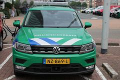 Logo of the security organisation Rotterdam Rijnmond named Veiligheidsregio in the Netherlands on front of green car with blue and. White striping stock image