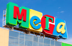 Logo of shopping center Mega against blue sky. Mega is the one o Stock Photos