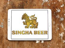 Singha beer logo. Logo of Singha beer on samsung tablet on wooden background Stock Photo