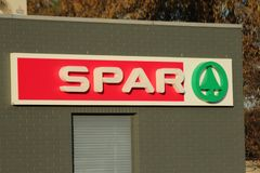 Logo of SPAR supermarktet at a Esso petrol station in NIeuwerkerk aan den ijssel in the Netherlands. Logo of SPAR supermarktet at a Esso petrol station in stock image