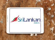 SriLankan Airlines logo. Logo of SriLankan Airlines on samsung tablet on wooden background. SriLankan Airlines is the flag carrier of Sri Lanka and a member of royalty free stock photography