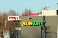 Logo of Subway fast food at a Esso petrol station in NIeuwerkerk aan den ijssel in the Netherlands. Logo of Subway fast food at a Esso petrol station in stock photos