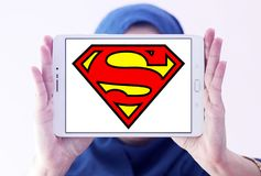 Superman logo. Logo of Superman on samsung tablet holded by arab muslim woman. Superman is a fictional superhero appearing in American comic books published by royalty free stock photography