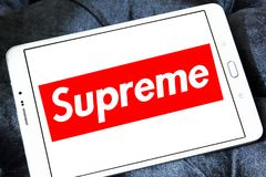 Supreme brand logo. Logo of Supreme brand on samsung tablet. Supreme is an American skateboarding shop and clothing brand stock photos