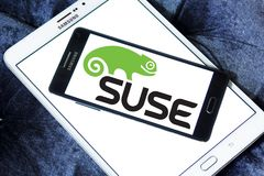 SUSE software company logo. Logo of SUSE software company on samsung mobile. SUSE is a German based, multinational, open source software company that develops stock photo