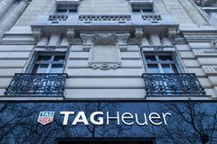 Tag Heuer logo on their main shop on Champs Elysees avenue. Logo of Tag Heuer on their main shop on Champs Elysees avenue in Paris, France, during a cloudy Stock Image