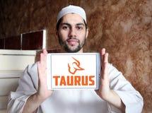 Taurus firearms manufacturer logo. Logo of Taurus firearms manufacturer on samsung tablet holded by arab muslim man. Forjas Taurus manufacturing firearms, metals Royalty Free Stock Photo