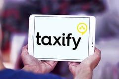 Taxify transportation company logo. Logo of Taxify transportation company on samsung tablet . Taxify is an international transportation network company. The royalty free stock photo