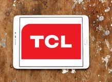 TCL Corporation logo. Logo of TCL Corporation on samsung tablet on wooden background. TCL is a Chinese multinational electronics company Stock Image
