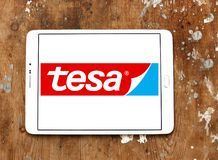 Tesa tape manufacturer logo. Logo of tesa tape manufacturer on samsung tablet. tesa tape, inc. is a leading manufacturer of adhesive tape solutions Stock Images