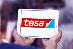 Tesa tape manufacturer logo. Logo of tesa tape manufacturer on samsung tablet. tesa tape, inc. is a leading manufacturer of adhesive tape solutions Stock Photography