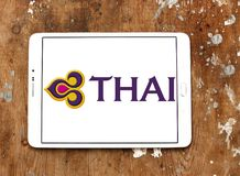 Thai Airways logo. Logo of Thai Airways on samsung tablet on wooden background. Thai Airways International Public Company is the flag carrier airline of Thailand stock photography