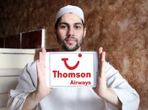 Thomson Airways logo. Logo of Thomson Airways on samsung tablet holded by arab muslim man. Thomson, is the world`s largest charter airline Royalty Free Stock Image