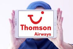 Thomson Airways logo. Logo of Thomson Airways on samsung tablet holded by arab muslim woman. Thomson, is the world`s largest charter airline Royalty Free Stock Image