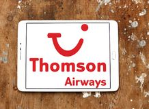 Thomson Airways logo. Logo of Thomson Airways on samsung tablet on wooden background. Thomson, is the world`s largest charter airline Royalty Free Stock Photos