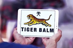 Tiger Balm brand logo. Logo of Tiger Balm brand on samsung tablet. Tiger Balm is the trademark for a heat rub manufactured and distributed by Haw Par Healthcare Royalty Free Stock Image