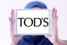 Tod`s fashion brand logo. Logo of Tod`s fashion brand on samsung tablet holded by arab muslim woman. Tod`s Group, is an Italian company which produces luxury royalty free stock photo