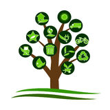 Logo. A tree with green ecological symbols Stock Photo