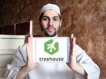 Treehouse company logo. Logo of Treehouse company on samsung tablet holded by arab muslim man. Treehouse is an online technology school that offers beginner to stock photography