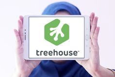 Treehouse company logo. Logo of Treehouse company on samsung tablet holded by arab muslim woman. Treehouse is an online technology school that offers beginner to royalty free stock photos