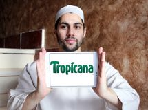 Tropicana logo. Logo of Tropicana juice company on samsung tablet holded by arab muslim man. Tropicana Products, Inc. is an American multinational company which Stock Photo