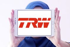TRW Automotive logo. Logo of TRW Automotive on samsung tablet holded by arab muslim woman. TRW Automotive is an American global supplier of automotive systems Stock Image