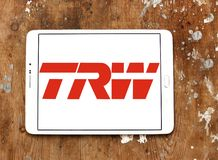 TRW Automotive logo. Logo of TRW Automotive on samsung tablet on wooden background. TRW Automotive is an American global supplier of automotive systems, modules Stock Photos