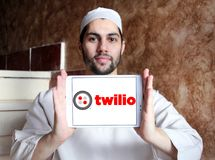 Twilio communications company. Logo of Twilio company on samsung tablet holded by arab muslim man. Twilio is a cloud communications platform as a service PaaS Stock Image