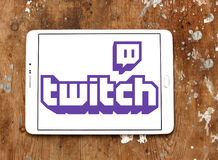 Twitch mobile logo. Logo of Twitch on samsung tablet on wooden backround. twitch is a live streaming video platform for gamers owned by amazon Stock Image