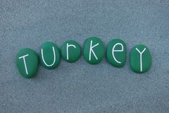 Turkey, country name with green colored stones. Logo type of the middle orient country of Turkey composed with green colored stones over green sand royalty free stock image