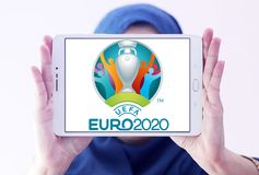 UEFA Euro 2020 logo. Logo of UEFA Euro 2020 on samsung tablet holded by arab muslim woman. The 2020 UEFA European Football Championship is scheduled to be the Royalty Free Stock Photo